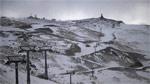 В Домбае валит снег, но его сдувает ветром - фото 1 - увеличить